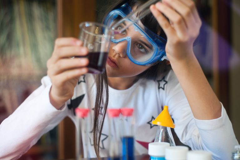 Young girl doing science