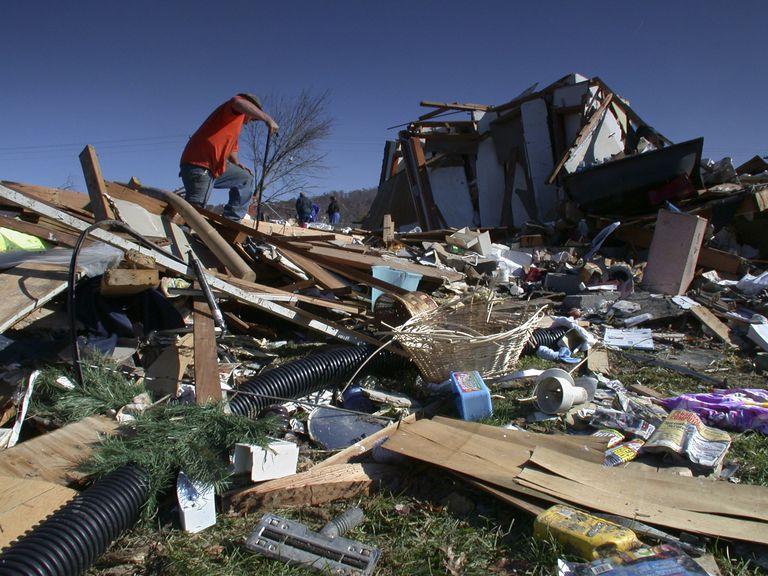 Tornado Victim Looking at Rubble
