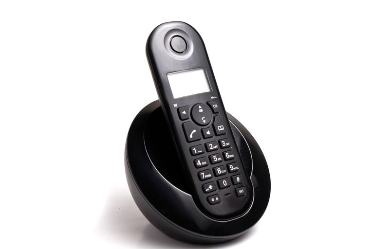 A cordless phone in its cradle.