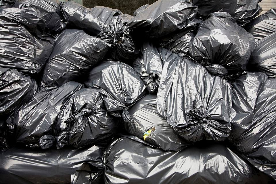 A pile of black rubbish bags.