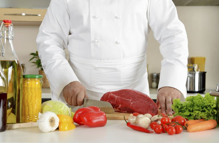 chef preparing meat and vegetables