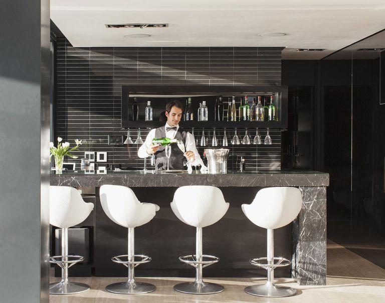 Waiter making drinks in bar