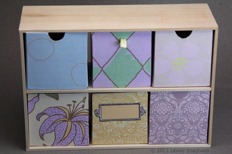Set of free printable storage boxes housed in a simple wooden case built from craft wood.