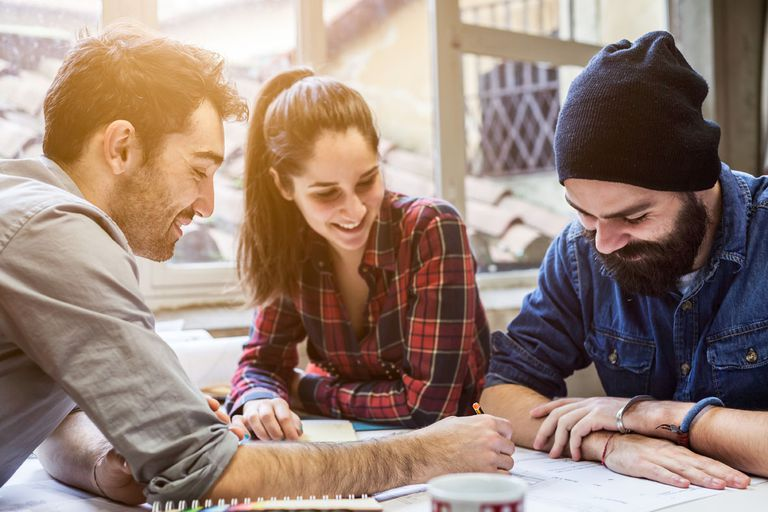 3 people in a team meeting