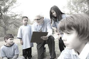 Retired volunteer helping children.