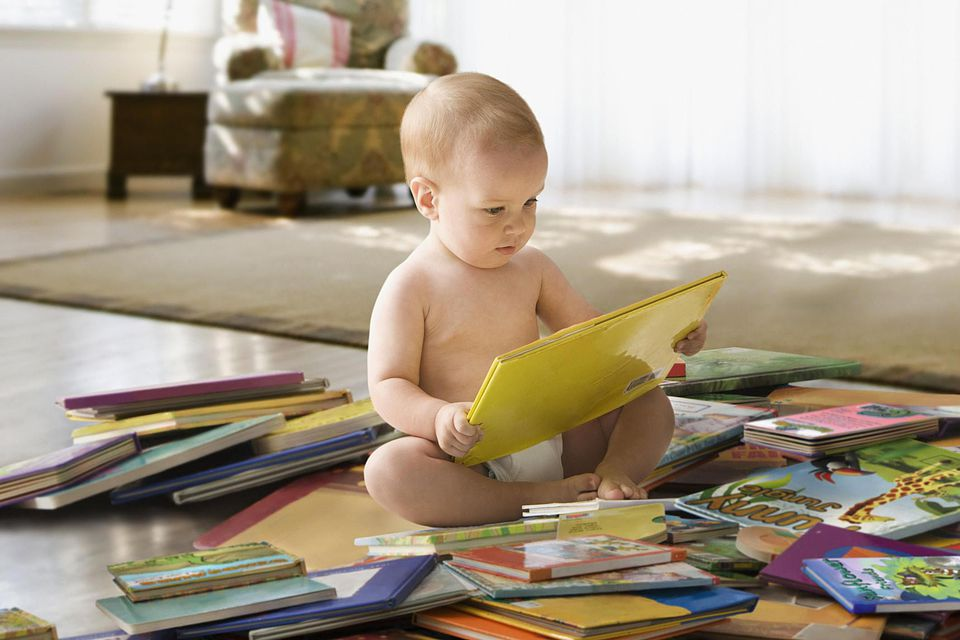 baby picking up book