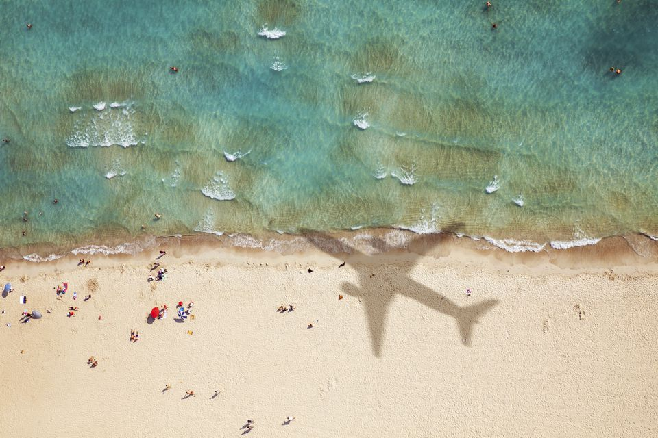 Airplane flying over beach