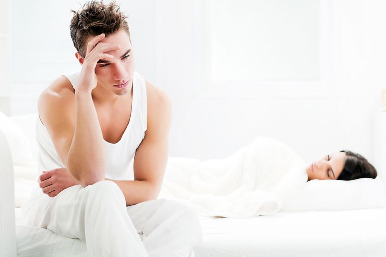 Man is upset while partner sleeps