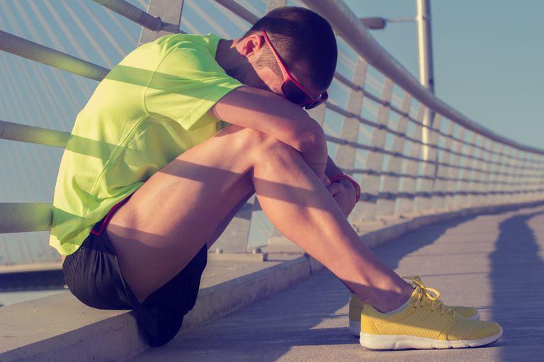man resting during exercising