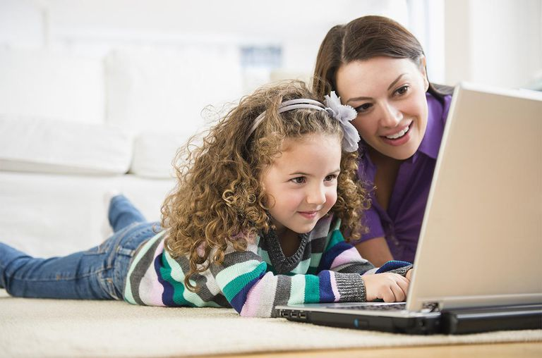Mother and daughter on laptop together