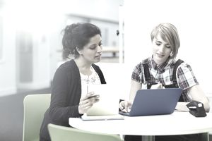 Teacher and student on laptap