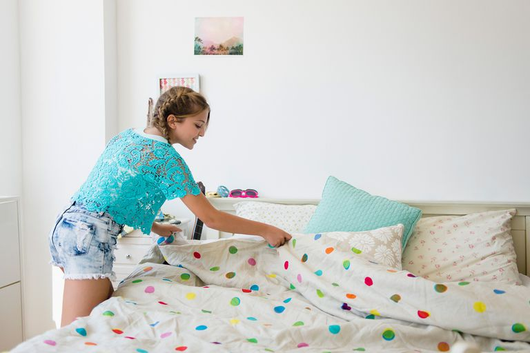 girl making the bed