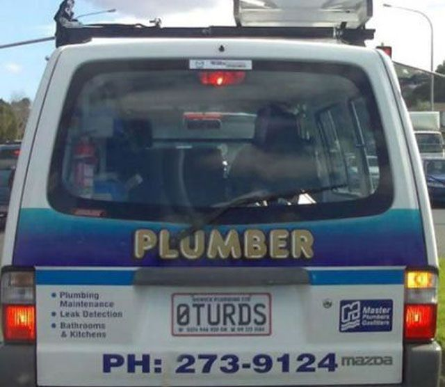 Plumber car with 0Turds license plate.