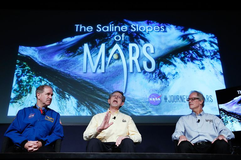 NASA spokesmen announcing discovery of salty, liquid water on Mars