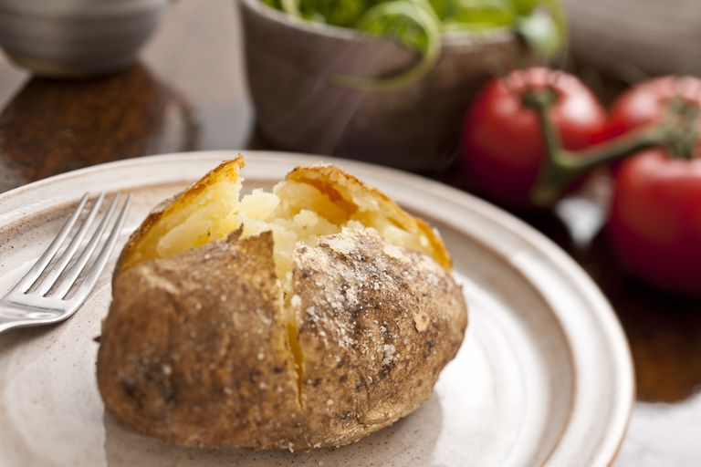Steaming hot plain baked potato