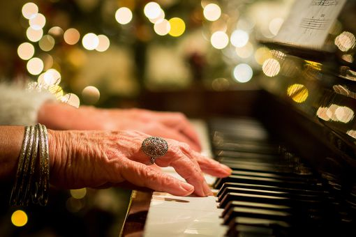 Woman playing piano Christmas