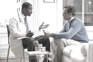 Doctor Discussing Medicine in His Clinic With a Patient