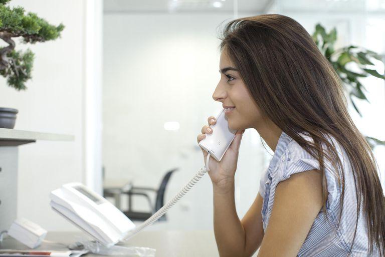 Woman talking on landline telephone
