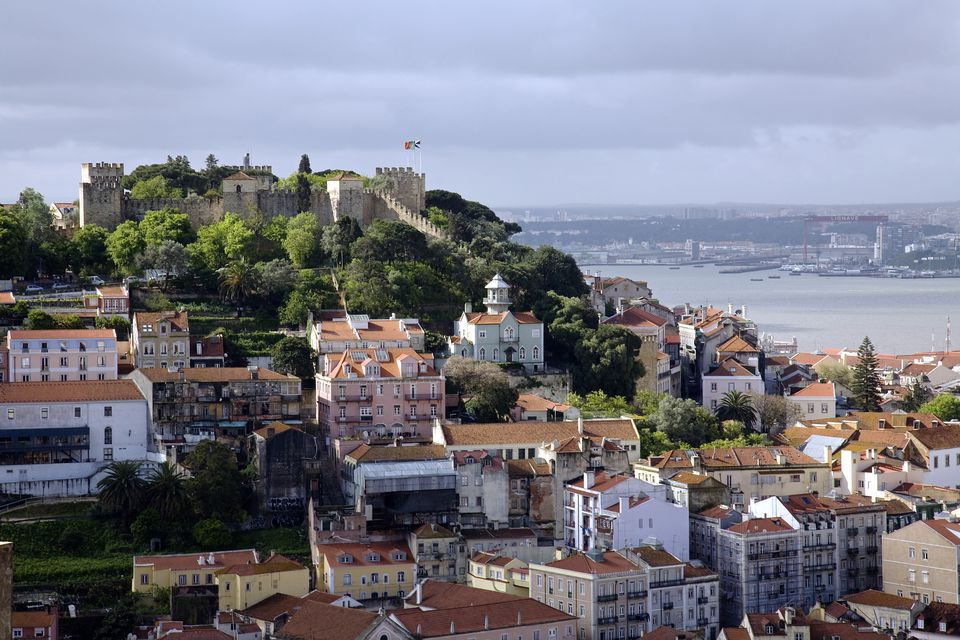 Portugal, Lisbon. The Castelo Sao Jorge in Lisbon with the Rio Tejo in the background.