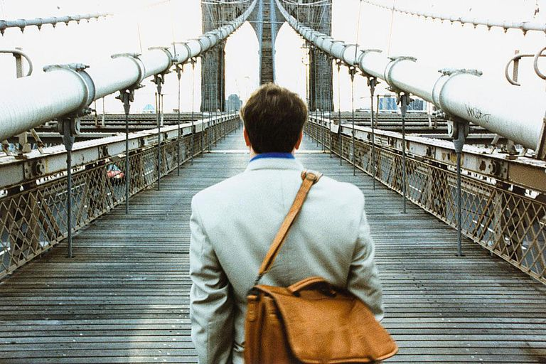 Businessman on Brooklyn Bridge