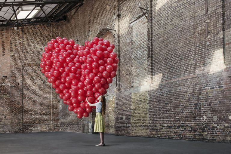 Woman With Balloon Heart