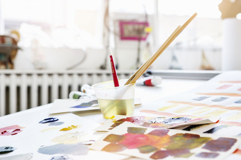 Still life of painting table with brushes