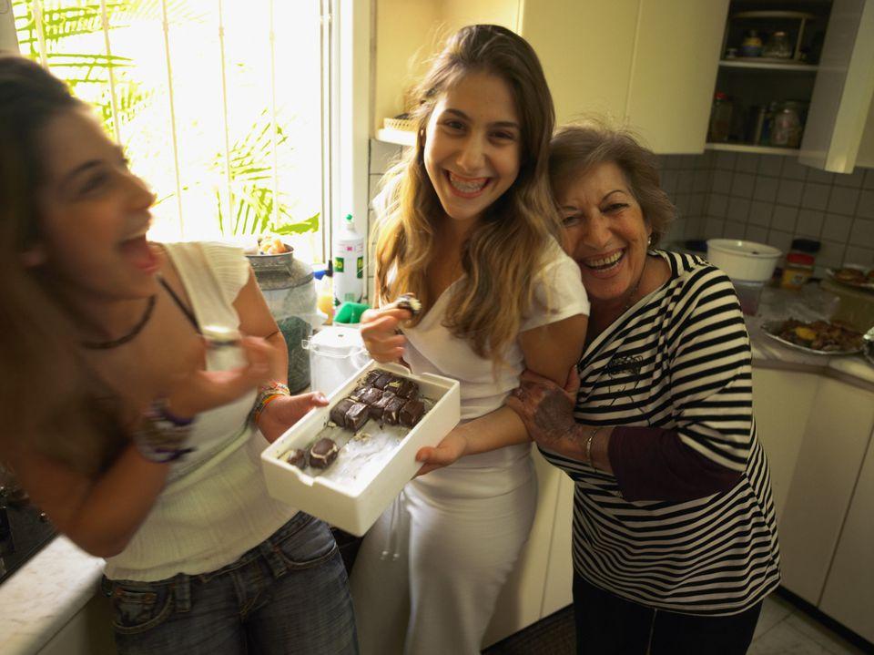 grandmother and granddaughters enjoy multigenerational living