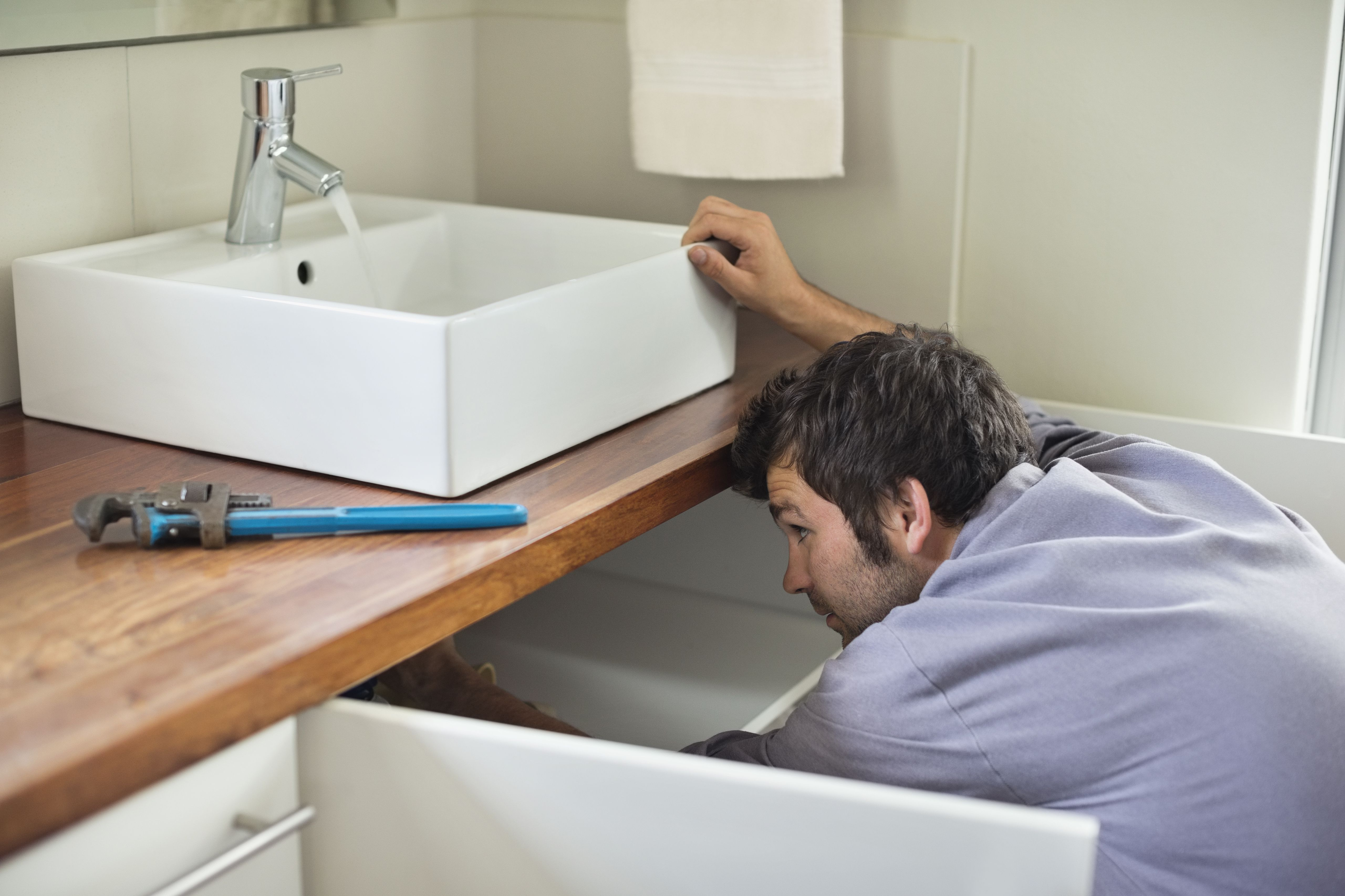 How to repair a leak in a pvc joint or pipe for Fixing bathroom sink