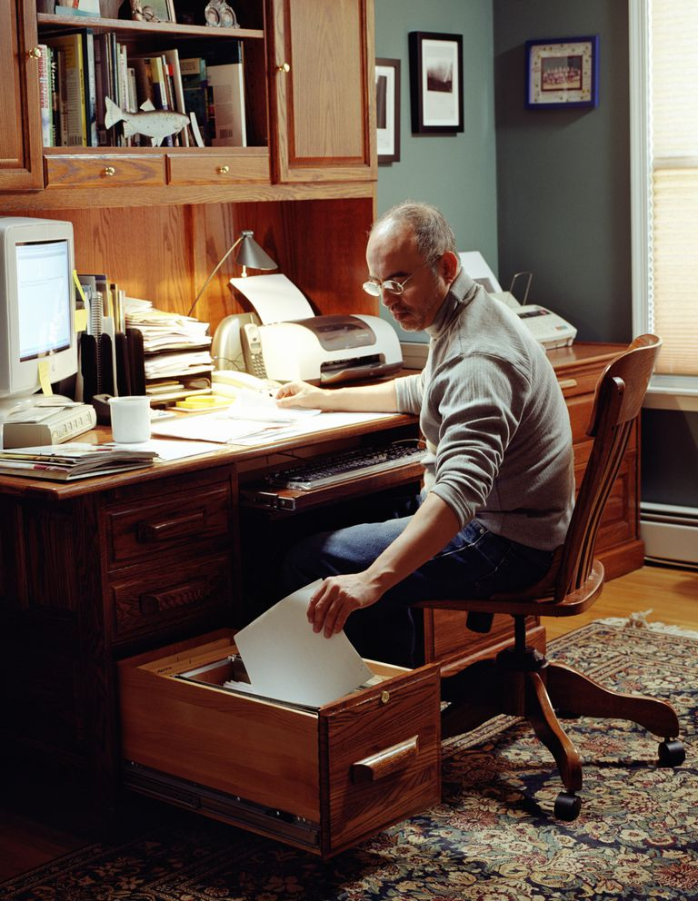 man filing in home office