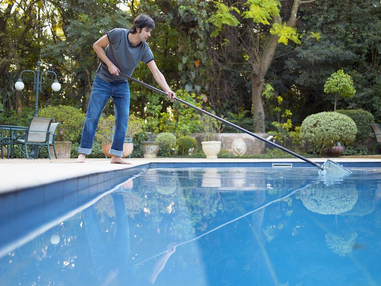 Man cleaning his pool to avoid mosquitos