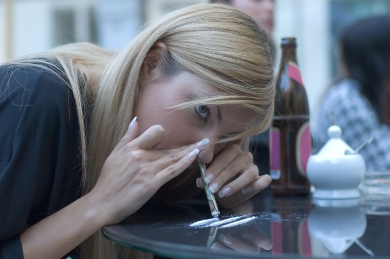 Woman Snorting Cocaine