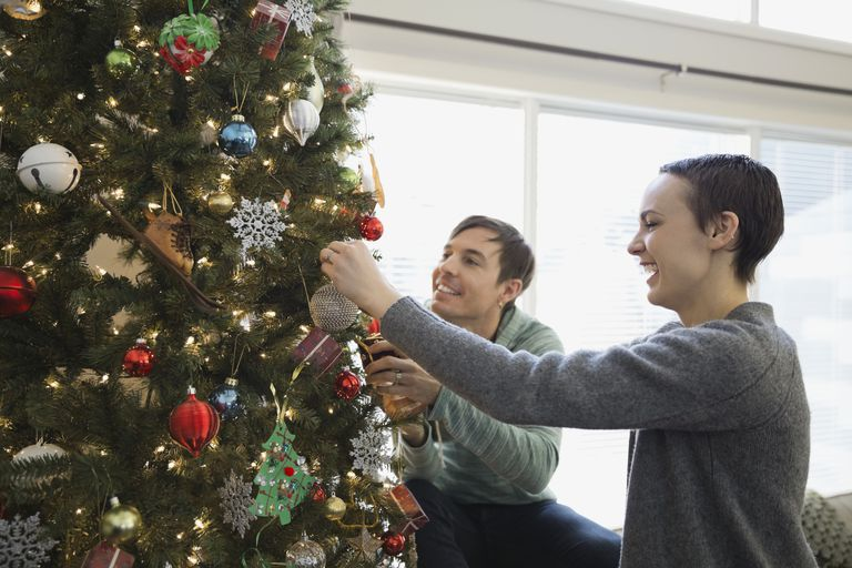 coupld decorating a Christmas tree
