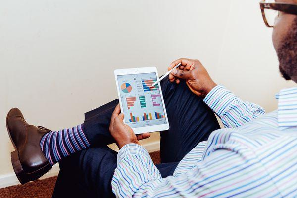 Man using ipad to look at savings