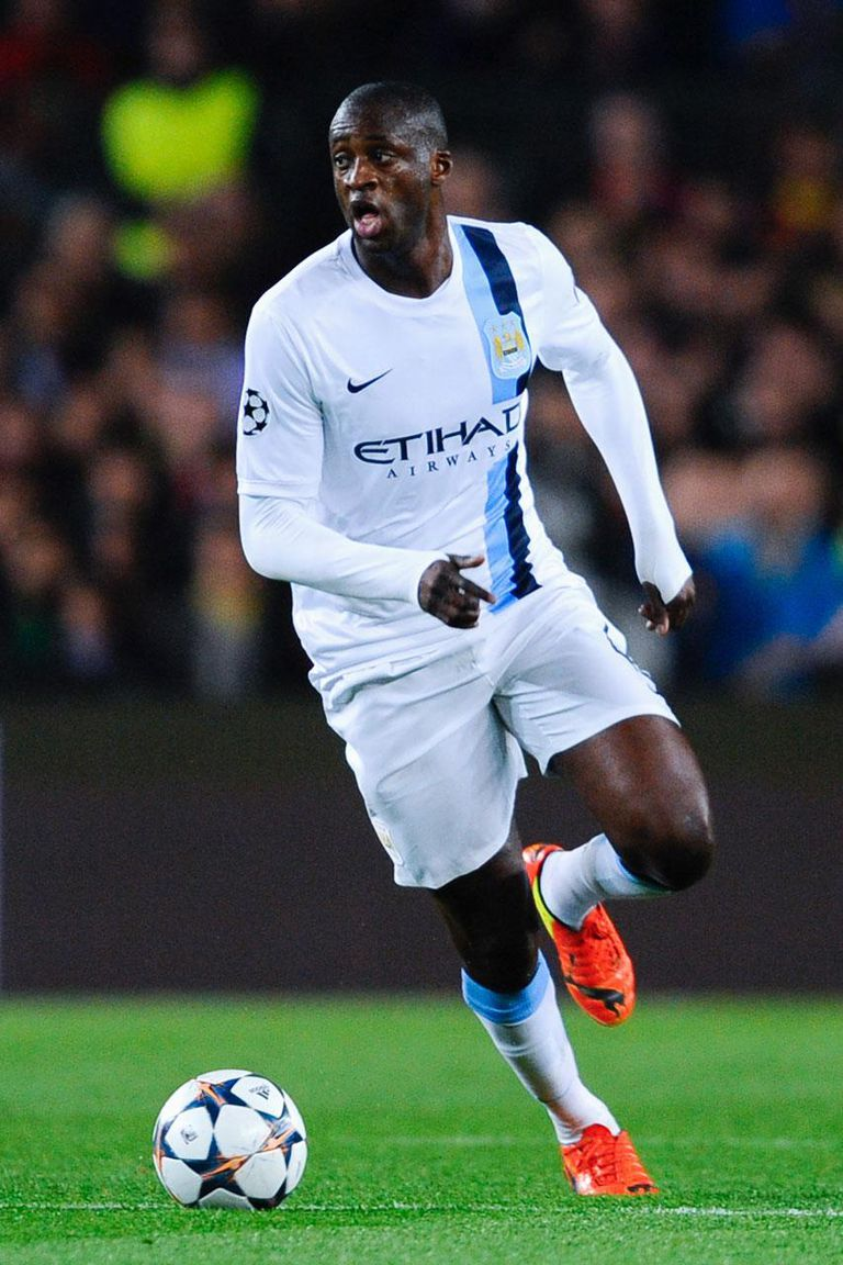 BARCELONA, SPAIN - MARCH 12: Yaya Toure of Manchester City FC runs with the ball during the UEFA Champions League Round of 16 second leg match between FC Barcelona and Manchester City at Camp Nou on March 12, 2014 in Barcelona, Spain.
