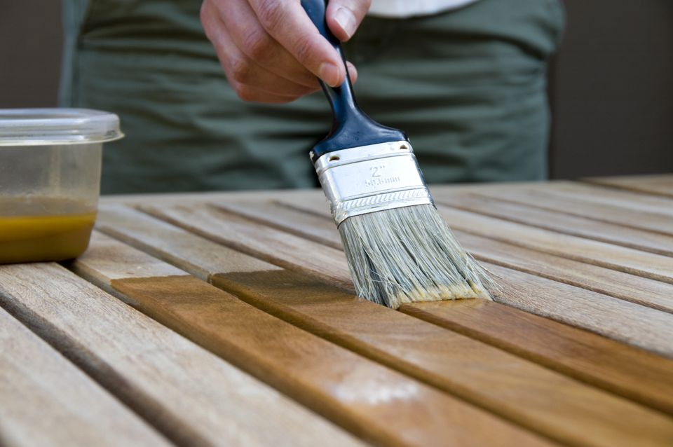 Woman Applying Stain to Wood