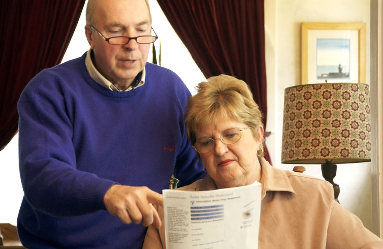 Senior couple reading Social Security form