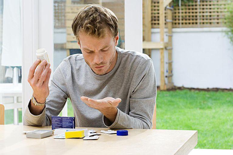 Man looking at tablets