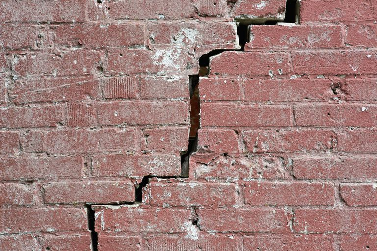 Crack in red brick wall