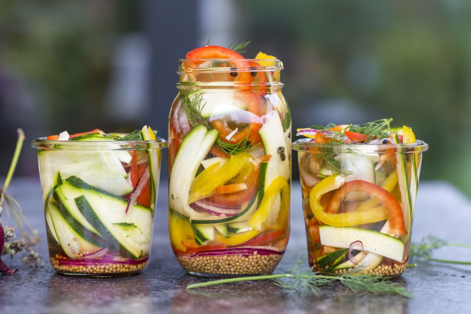 Pickeled vegetables and herbs in preserving jar