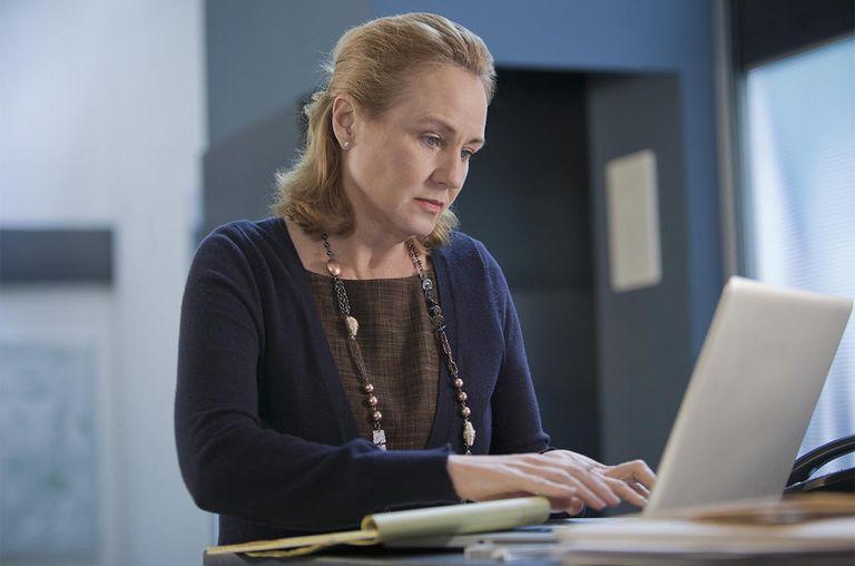 Caucasian businesswoman using laptop