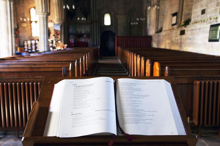 A holy book on a platform at the front of a church