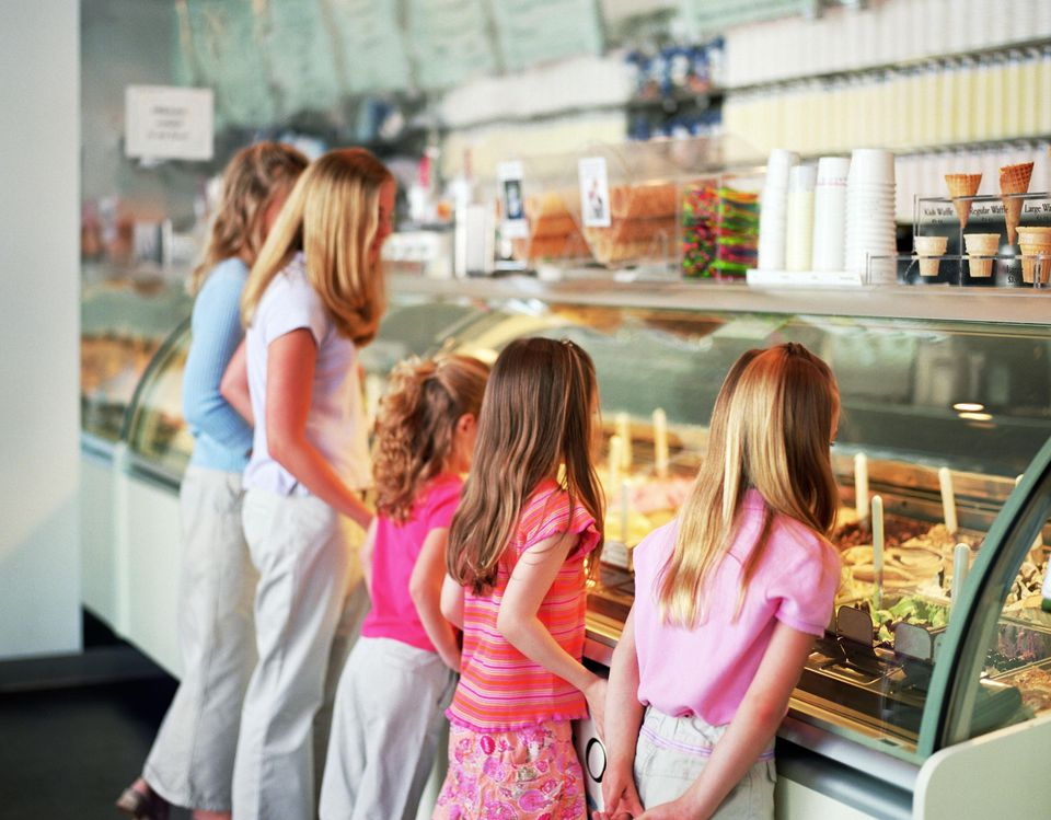A family looking at treats in a bakery shop