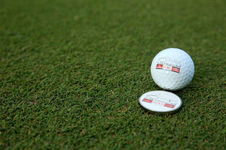 Golf ball marker on a putting green