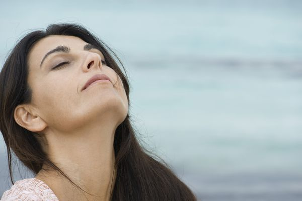 woman doing breathing exercise