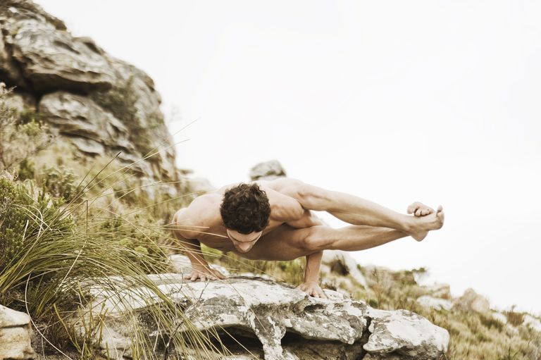 Man practicing yoga on a rock, South Africa