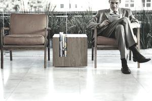 Man reading a finance magazine.