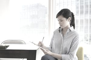 Young businesswoman working on paperwork in office