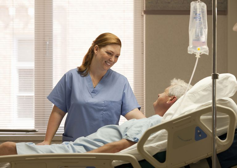 Female nurse with male patient in hospital
