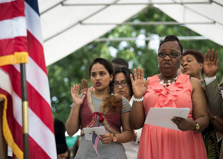 Group of immigrants becoming US citizens during a naturalization ceremony
