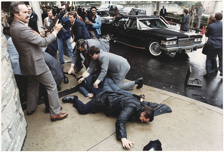 Photograph of chaos outside the Washington Hilton Hotel after the assassination attempt on President Reagan